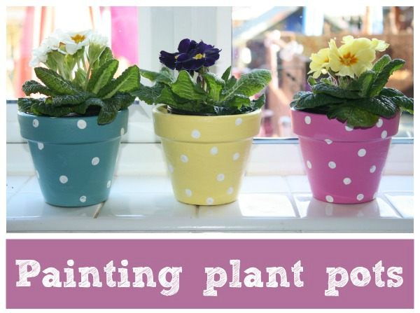 kid painted plant pots