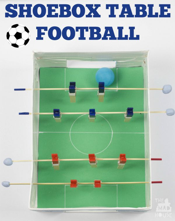 Shoebox table football/foosball game. This fab DIY football or foosball table is perfect for making with the kids and having loads of fun with. This is a super fun DIY craft that uses recyclables and perfect for kids.