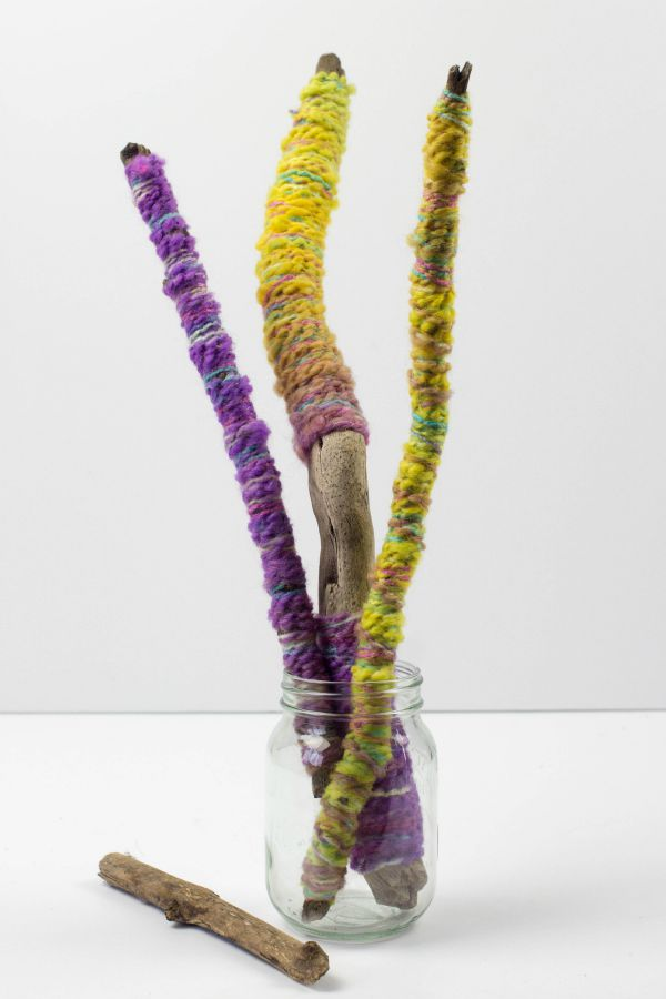 yarn wrapped sticks in jar