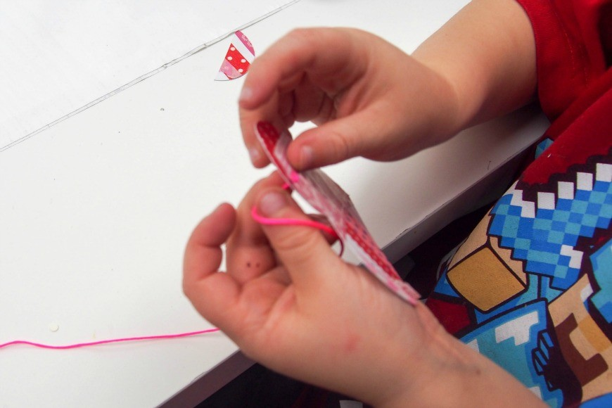 Washi Tape Hearts - Process Art for Preschoolers. This stunning kids craft is perfect for valentine's day, but it is also a great kids art activity and you can make a beautiful DIY heart garland with the upcycled artwork.