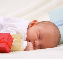 Colorful gift boxes with sleeping baby