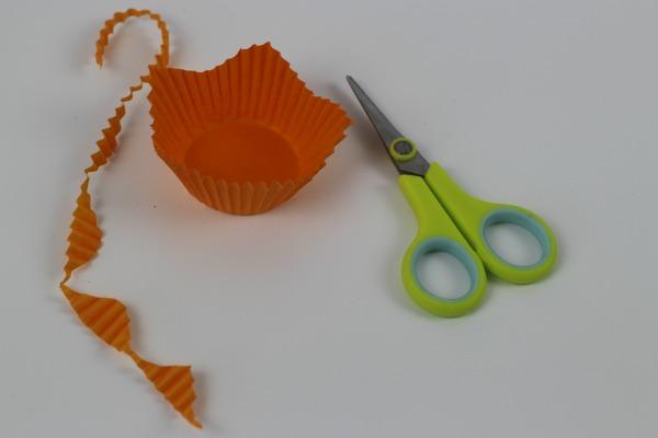 An Orange cake case cut to resemble a daffodil flower petal