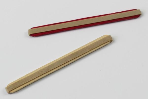 Elastic bands on popsicle sticks