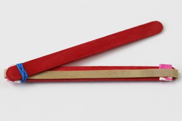 Elastic bands on popsicle sticks 4