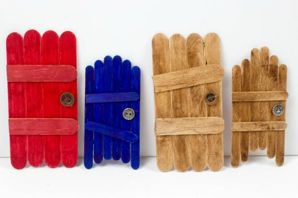 How to make craft stick fairy doors. Keep the magic of childhood alive with these super simple craft stick fairy doors