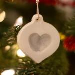 Make an adorable white clay Christmas fingerprint ornament