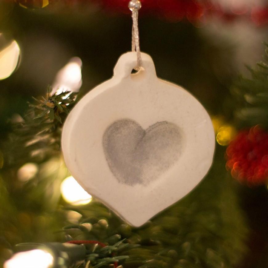Make an adorable white clay christmas fingerprint ornament for Christmas ornaments to make for gifts