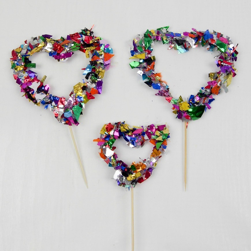 Hot Glue Gun Confetti Heart Cake Topper. This is a fab DIY craft to make a confetti heart, which is perfect as a cake topper for celebrations and if you only confetti one side they make a brilliant window cling. You could make any shape, letter, or number. You could even frame it as art instead of putting a toothpick in it as a cake topper
