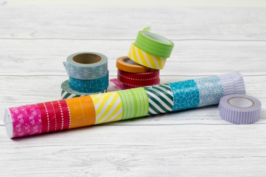 DIY Rainmaker or rainstick craft for kids. This is a super simple craft and musical instrument activity for children. Traditionally made from dried cacti, this simple DIY rainstick has the same sound and is also a perfect rainbow craft too