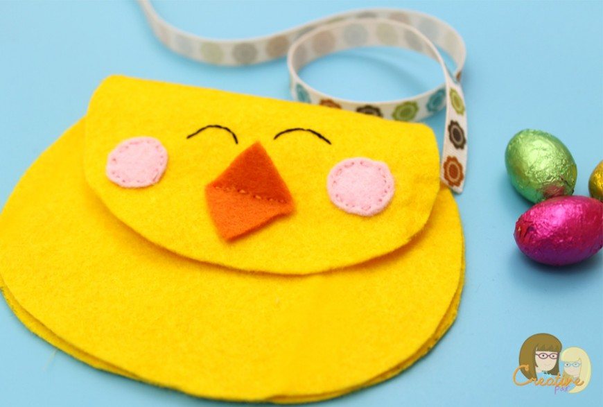 This cute felt chick purse is the perfect introduction in to sewing.  A simple DIY craft sewing project to hold your kids Easter eggs this Spring.