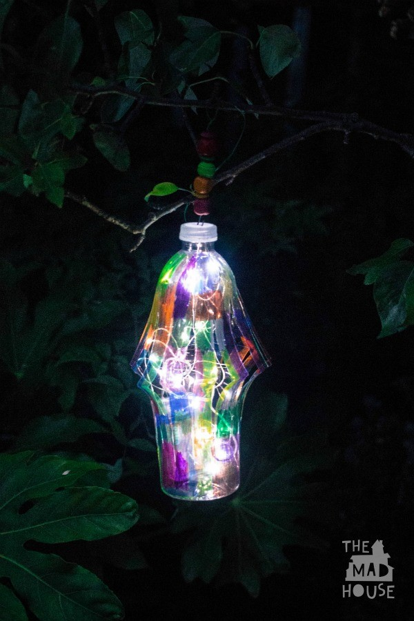 DIY Garden lantern - This is a fantastic DIY craft for upcycling plastic bottles. A beautiful plastic bottle DIY garden lantern.