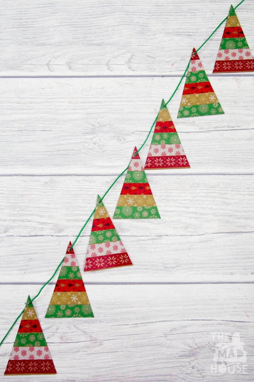 A simple Washi Tape Christmas Trees Garland. This is a super fun and simple kids craft perfect for the festive season using washi tape