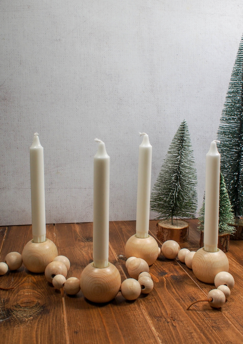 This beautiful DIY Advent Candle is Inspired by the Ferm Living Wooden Bead one. Find out how simple it is to make your own wooden bead advent candle.