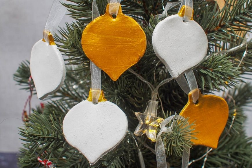 Gold and White Air Drying Clay Christmas Decorations on tree