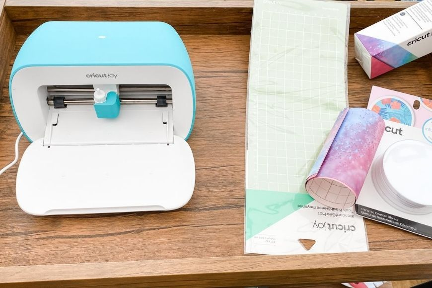 Cricut joy and materials to make DIY coasters with infusible ink
