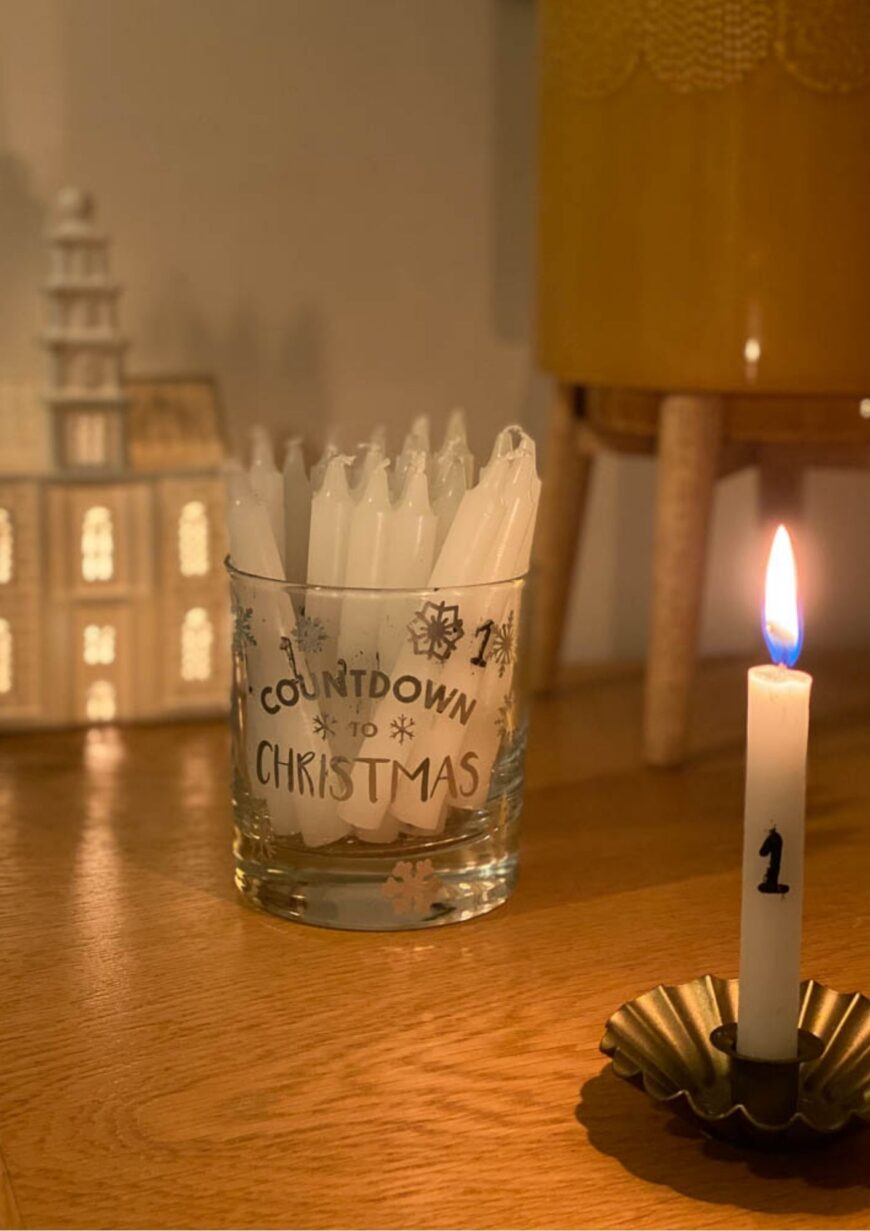 Tutorial to make 24 DIY Numbered Advent Candles perfect for the build-up to Christmas. These advent candles are perfect for December.
