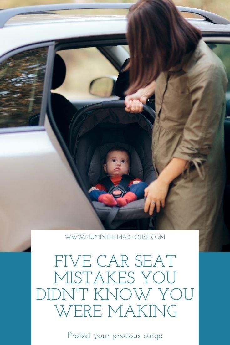 Mum holding baby in car seat