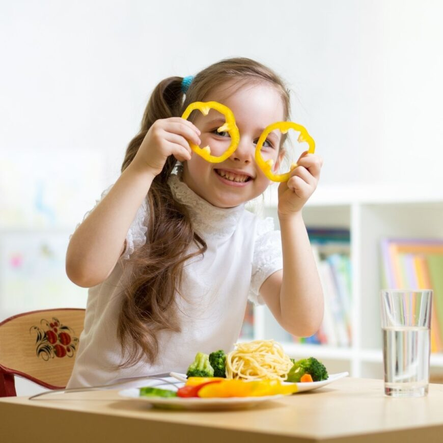 Girl with pepper lices in from of her eyes eating a simple lunch