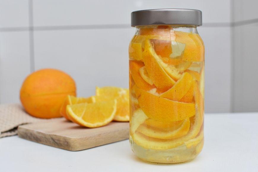 A Jar of orange peels and white vinegar