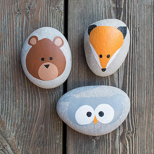 Woodland animals painted on to stones