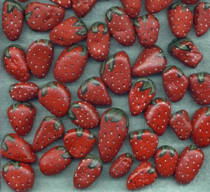 Rocks painted to look like strawberries