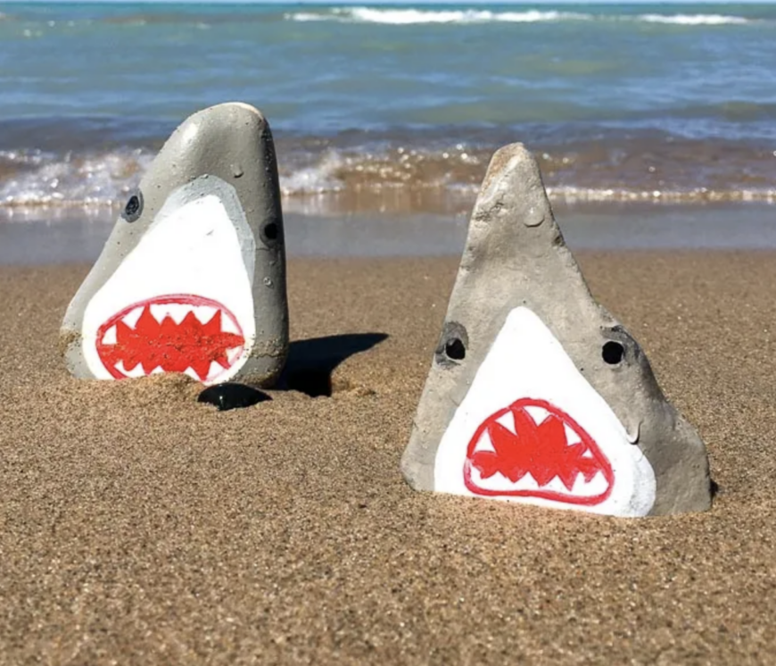 Rocks painted as sharks