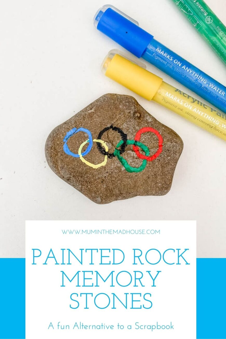 A rock with the olympic rings painted on