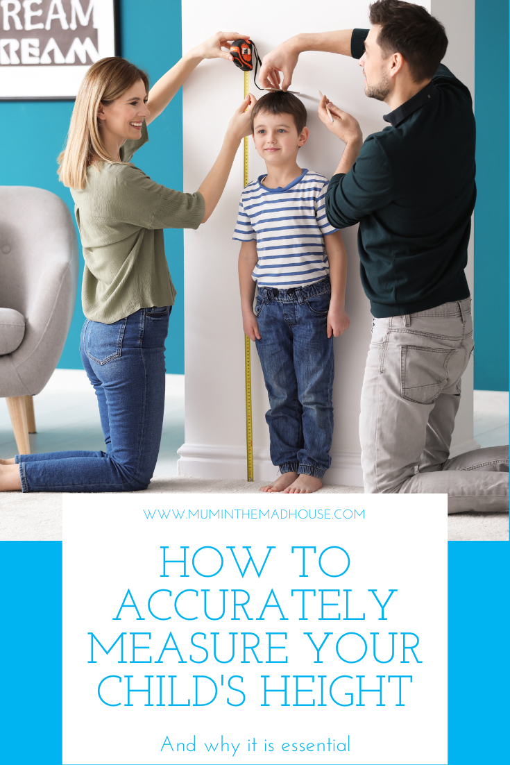Parents measuring height of their son at home